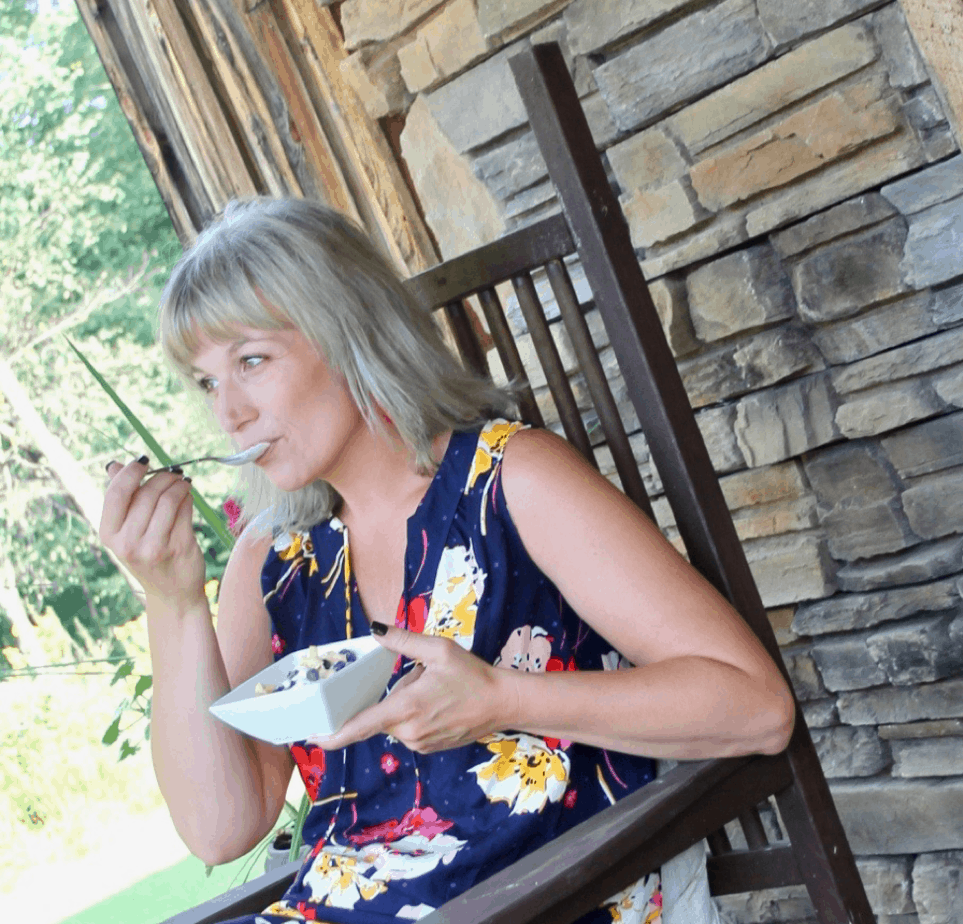 woman eating fage yogurt