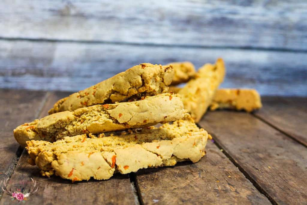 Carrot Cake Biscotti is a just like carrot cake but in a crunchy cookie form. We make our carrot cake biscotti without nuts but you can easily add in walnuts or pecan if you like. These are the perfect biscotti.