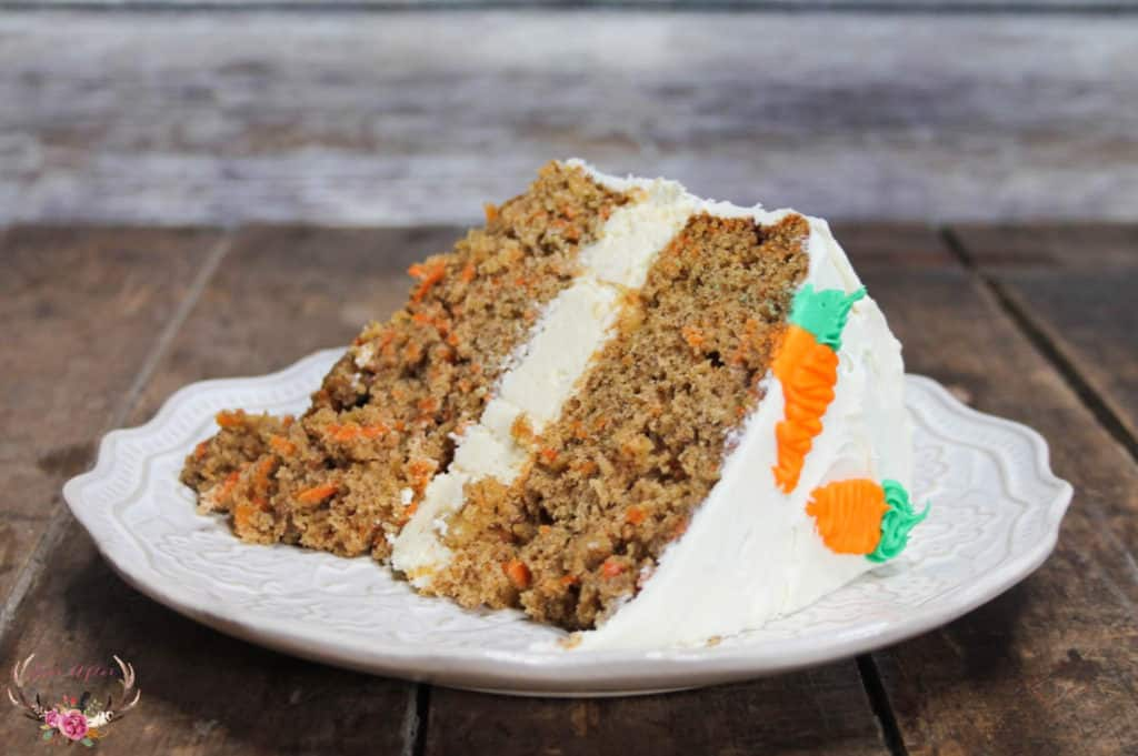 If you love carrot cake and cheesecake then this Carrot Cake Cheesecake cake is just what you need. This cake is made of 2 moist layers of carrot cake and one delicious layer of cheesecake in between and smothered with cream cheese frosting.