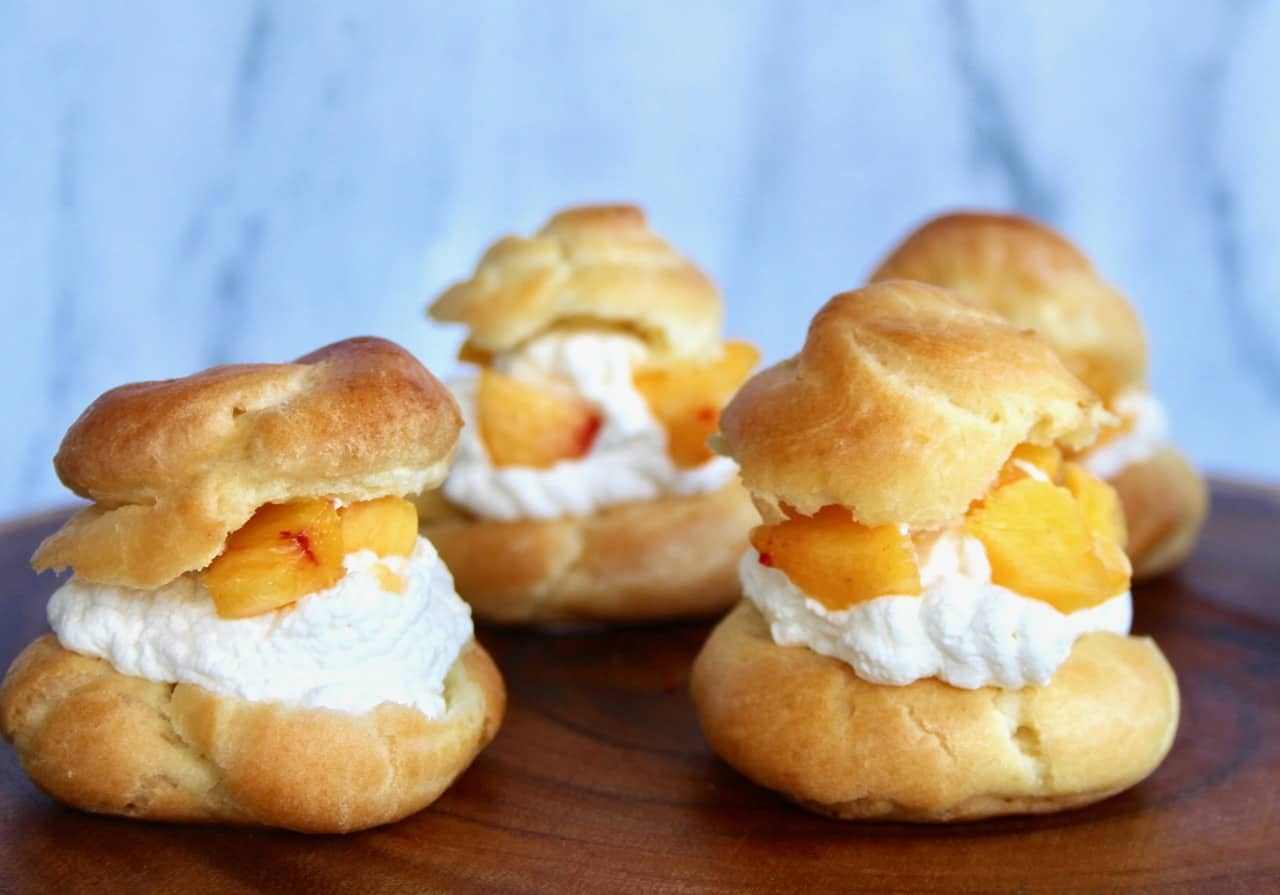 the ultimate cream puffs with peach chantilly cream whipped cream