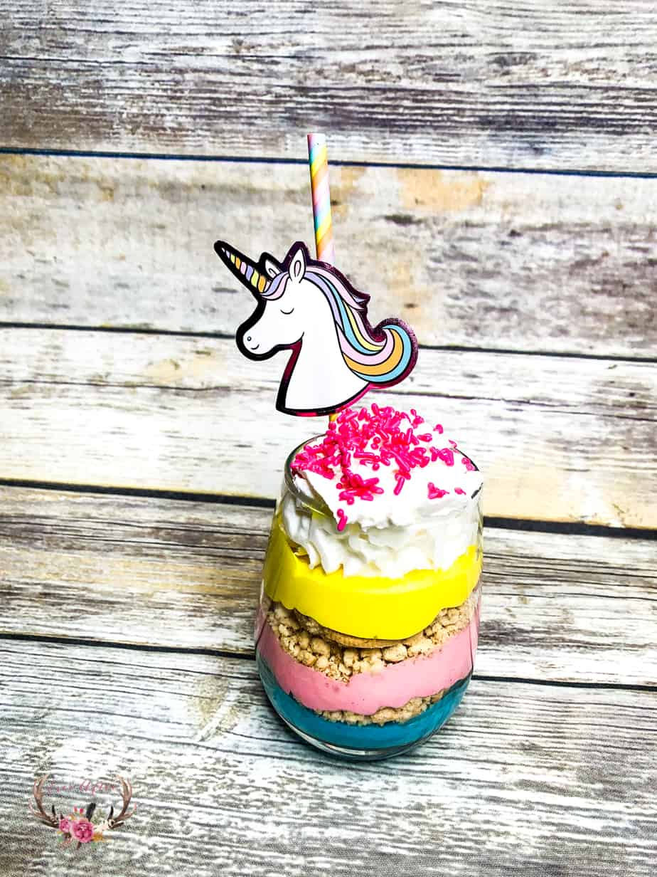 These unicorn parfaits are layers of brightly colored pink, purple and yellow pudding with crushed vanilla cookies in between the decadent layers.