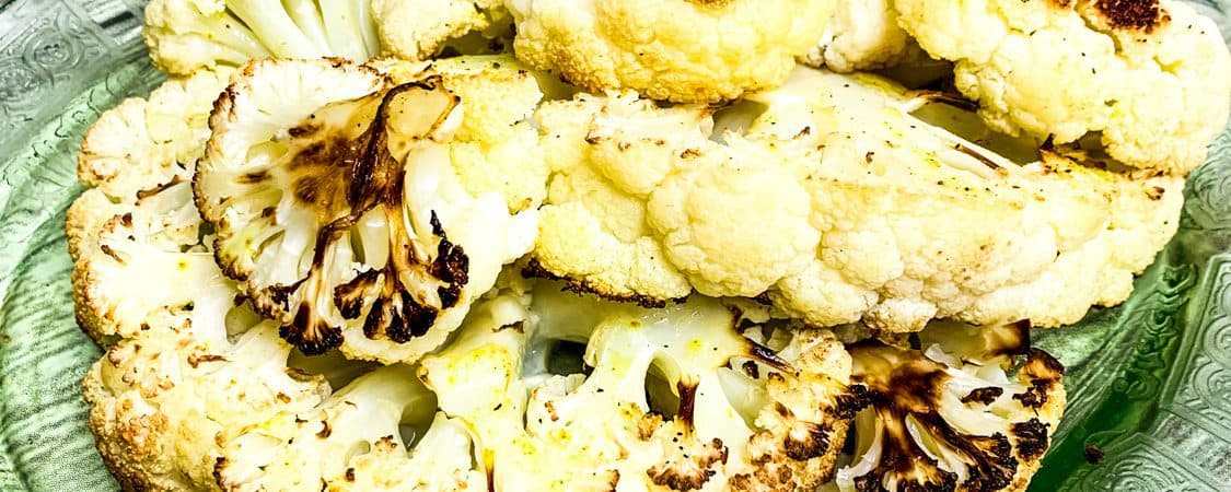 I think I may have just made the best roasted cauliflower ever! The cauliflower is soft and sweet with caramelized edges – It is so good, I may or may not have eaten the entire head of cauliflower myself.