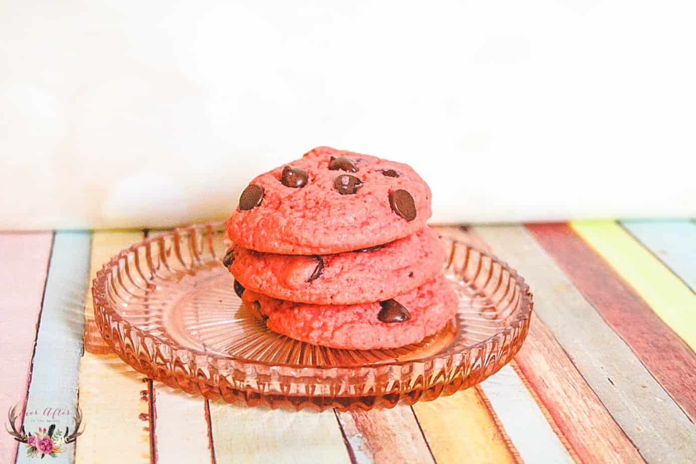 I love making desserts that are pretty to look at and also taste amazing too. My husband loves a classic red velvet cake or cookie. I decided to make a pink velvet cookie with chocolate chips. These cookies are soft and delicious and will be the perfect touch to a Valentine's Day dessert.
